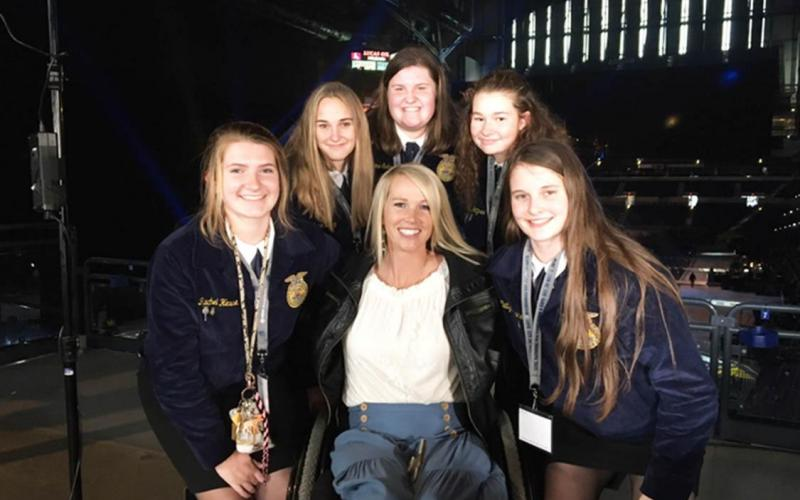 Sullivan FFA members shown with paraplegic rodeo champion and motivational speaker, Amberlee Snyder at National FFA Convention.