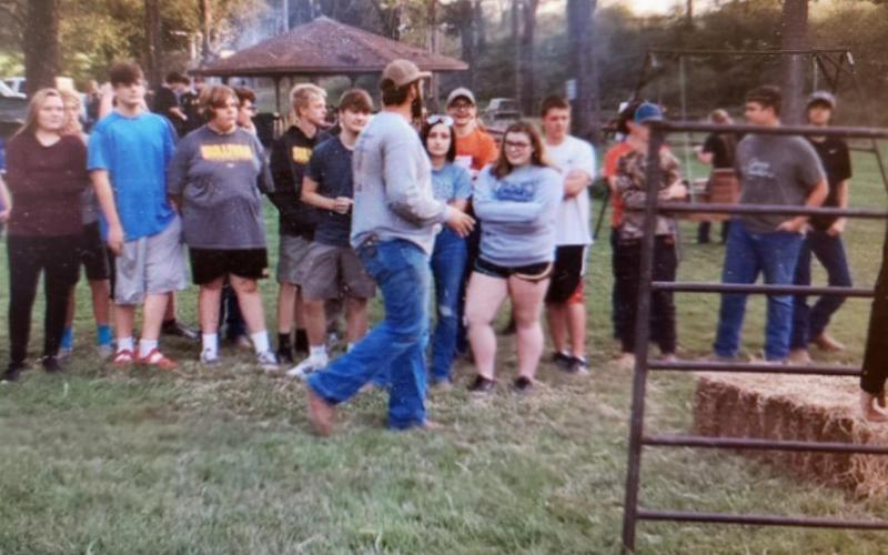 Chapter President Tyler Hesse prepares students for the bale stacking competition at the September FFA meeting held at Rohrer Park.